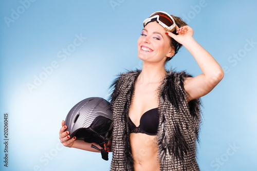 Tuinposter Wintersporten Woman wearing sexy winter sport outfit