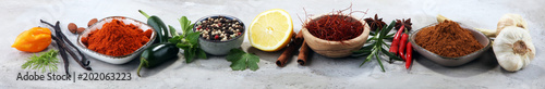 Fototapeta Spices and herbs on table. Food and cuisine ingredients. obraz
