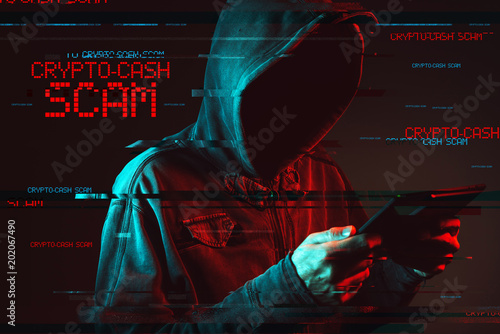Crypto cash concept with faceless hooded male person