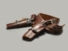 Two Old Handguns In Leather Holster
