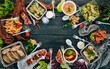 Leinwanddruck Bild - Food in lunch boxes. Delivery of food. Ukrainian cuisine. On a wooden background. Top view. Copy space.