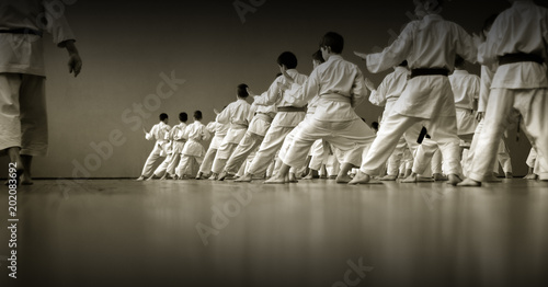 Kids training on karate-do. Black and white.