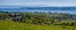 Panorama Blick über den schönen Bodensee mit Alpenblick und blauen Himmel
