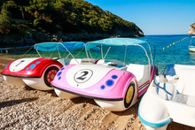 Colorful Pedalos On A Beautifu...