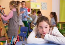 Sad Bored Schoolgirl In Classroom At Break