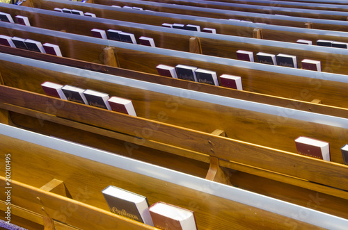 Fototapeta Bibles and Hymnals in Church Pews