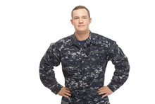 Young Man In Navy Uniform With Hands On Hips