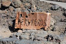 Los Hervideros Rusty Sign At Coastline In Lanzarote, Canary Islands, Spain