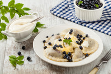 Delicious Dumplings With Fresh Blueberries Served With Whipped Cream And Sugar Or Sauce.
