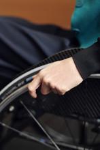 Woman Sitting On Wheel Chair