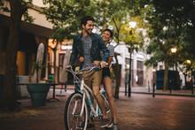 Loving Couple Riding Bicycle O...