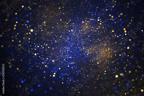 Fényképezés  Abstract glittering texture with golden and blue sparks