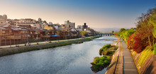 View To River Kamo In Evening Light. People Resting On The Bank After Working Day Near Pontocho Area