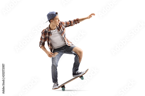 Teenage skater doing a manual