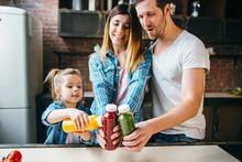 Family Drink Juice In The Kitc...