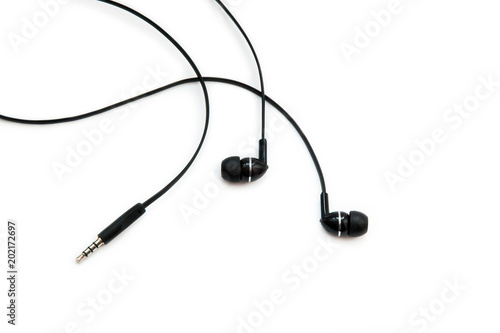 Valokuva  Black headphones for listening to music and sound on portable devices: music player, smartphone, laptop and jack for connection on a white background