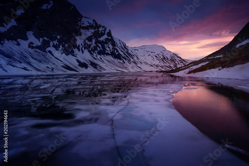 Fototapeta  Norway Glacier lake after sunset - drone photo, ice in foreground