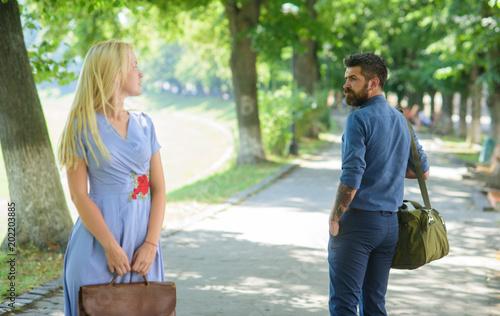 Obraz na płótnie Strangers girl and guy flirting looking each other on street.