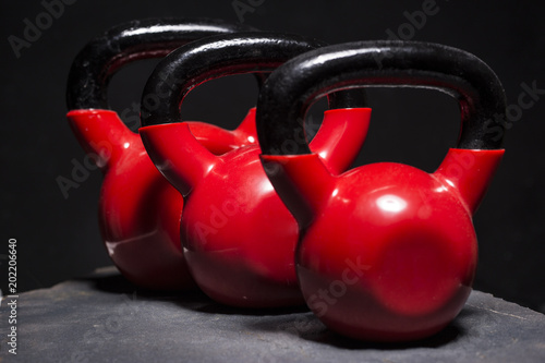 red kettlebells on roug surface