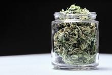 Marijuana Buds In Glass Jar On Table