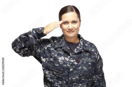 Obraz na plátne Smiling female navy officer saluting