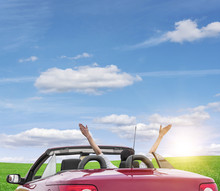 Young Woman In A Car With A Convertible On The Road To The Nature On A Sunny Day.
