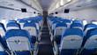 Empty aircraft cabin during flight. Blue salon.