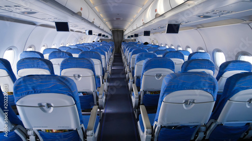Empty aircraft cabin during flight. Blue salon.