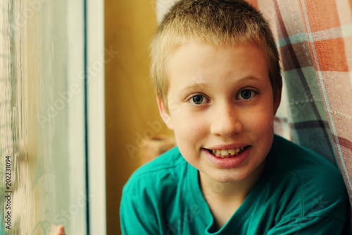 Cute 10 Year Old Autistic Boy Looking At The Rain Kaufen Sie