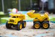 Construction toys in garden play in summer