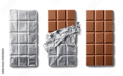 Top view of milk chocolate bar and chocolate bars in foil Canvas Print