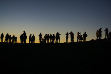 Silhouette Of Photographers Waiting For The Sun To Set