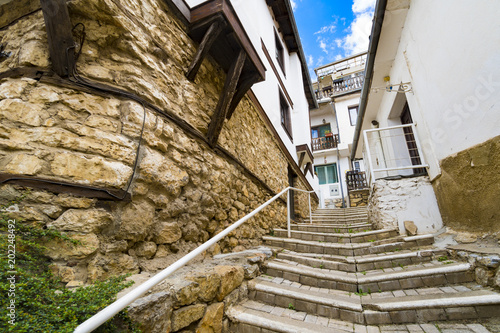 In de dag Stad aan het water Stairs in Old town in Ohrid, Macedonia. Ohrid and Lake Ohrid were accepted as Cultural and Natural World Heritage Sites by UNESCO