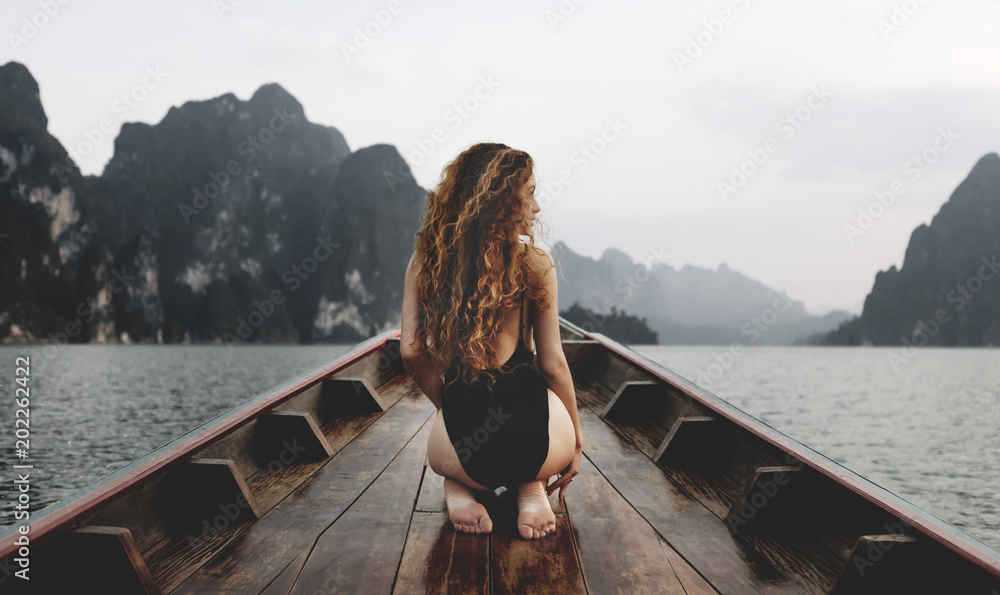 Fototapety, obrazy: Beautiful woman posing on a boat