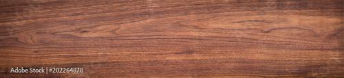 Türaufkleber Holz Walnut wood texture. Super long walnut planks texture background.