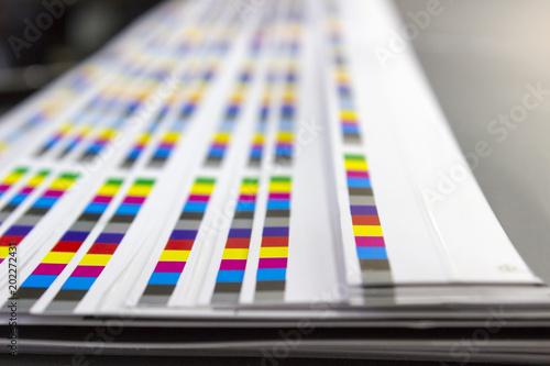 Fotografía CMYK color bars on printed sheets of paper