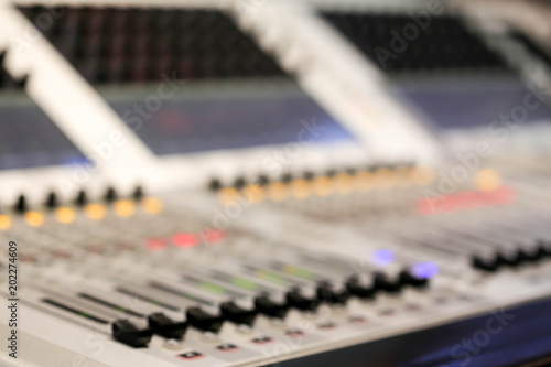 Blur of Equipment for sound mixer control in studio TV