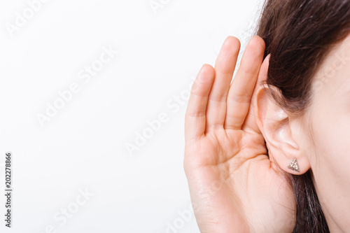 Valokuva  Young woman with symptom of hearing loss isolated on white