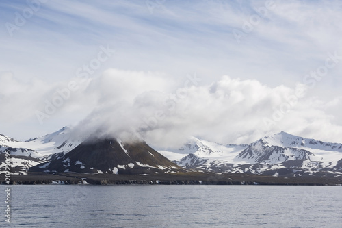 Poster Donkergrijs Landscape with snowy mountains on a sunny day seen from the sea in Spitsbergen, Norway