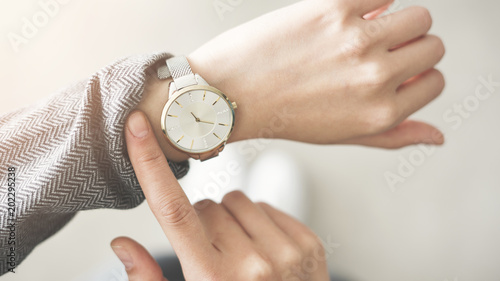 Woman checking time her watch