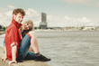 Loving couple spending leisure time together at seaside
