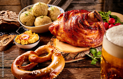 Fotografie, Obraz  Roasted ham hock, pretzel, cheese spread with beer