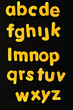 The alphabet in yellow letters on a black background
