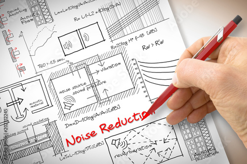 Valokuva  Engineer writing formulas about noise reduction in buildings - concept image