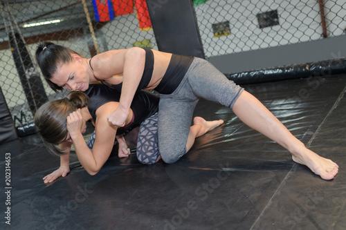 Fotografie, Obraz  two women wrestling