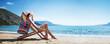 Leinwanddruck Bild - Woman Enjoying Sunbathing at Beach