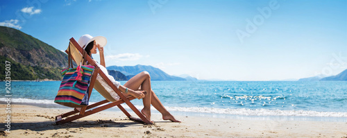 Obraz Woman Enjoying Sunbathing at Beach - fototapety do salonu