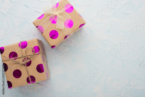 Foto  Two gifts on a light background with an empty space for writing or advertising