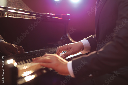 Close-up of a piano player Fotobehang