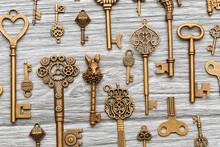 Vintage Antique Keys On A Light Wooden Background
